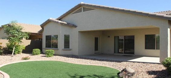 This Florence home for sale is close to Phoenix and offers a buyer a fully landscaped exterior with an immaculate interior.